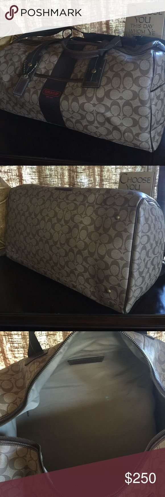 Authentic Coach Duffle bag Used but in great condition Duffle bag. Had a small stain inside but it's light . Coach Bags Travel Bags