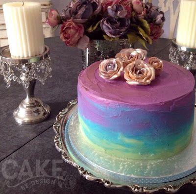 Tinted white Lindt chocolate ganache; moist dark chocolate cake; hand modeled chocolate roses. www.cakebydesign.co.za