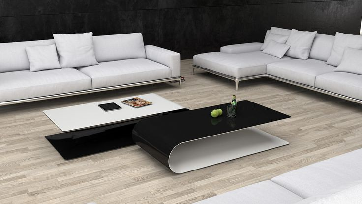 BOOMERANG/carbon. low table made of carbon fiber. table in fron transparent laquered carbon fiber on top, matte white paint inner part. table in background vice-versa.