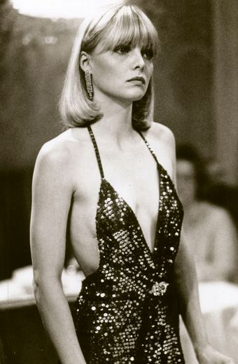 "Michelle Pfeiffer as ""Elvira Hancock"" in Scarface, 1983. Costume by Patricia Norris."