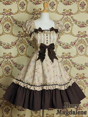 <3 Color (brown v. beige)  <3 Lower portion of dress, with ruffles and brown thread running across  <3 Detachable bow in center can be moved