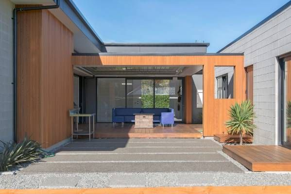RANGIORA, CANTERBURY: The house is a horse-shoe shape with a decked courtyard in the middle that's sheltered from the ...