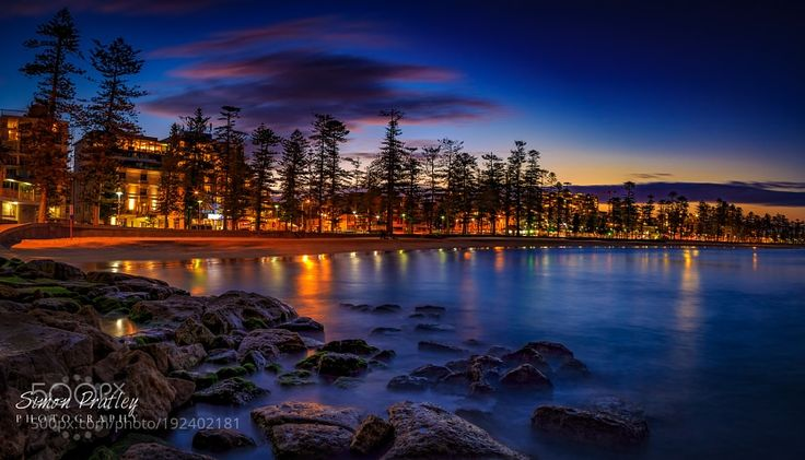 http://500px.com/photo/192402181 Evening at Manly Beach by simon_pratley -Manly Beach is a beautiful place day or night and is somewhere I have always felt at home. With Sydney Harbour on one side and the Pacific Ocean on the other I cant think of another place like it in the world. It attracts thousands of people to its beaches every day but I have to admit my favourite time to be here is when it is quite and it feels like you have the whole beach to yourself.  This photo was taken just…