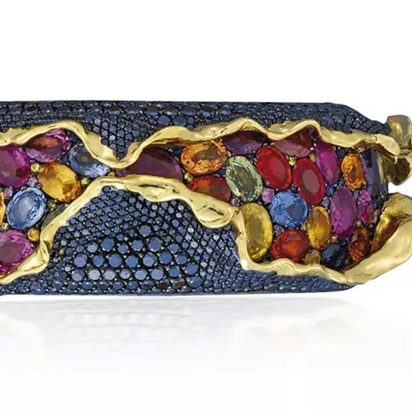 Lot 93 (2). An unusual suite of coloured diamond and coloured sapphire 'Craquele' jewellery, by Andre Marcha. Comprising a hinged bangle, ear clips and a ring. Estimate 50,000 - 60,000 U.S. dollars.