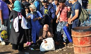 Asylum seekers wait to cross the Greece-FYROM border.  Meanwhile refugee boat sinking: dozens including children drown off Greek island, Capsizing of overcrowded boat in high winds off the Aegean island of Farmakonisi comes as Athens calls for more help to deal with growing crisis. http://www.theguardian.com/world/2015/sep/14/babies-and-children-among-34-dead-in-aegean-migrant-boat-sinking
