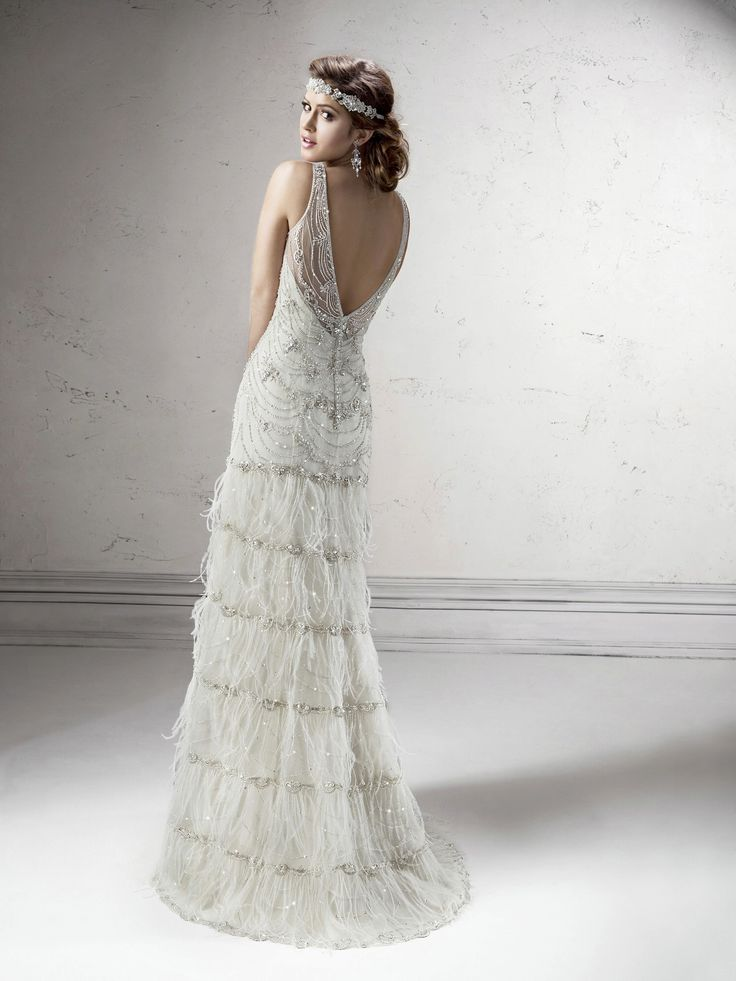 Gatsby wedding gown by Sottero + Midgley has some truly great 20s detailing, particularly that tiered feather skirt (very flapper!).