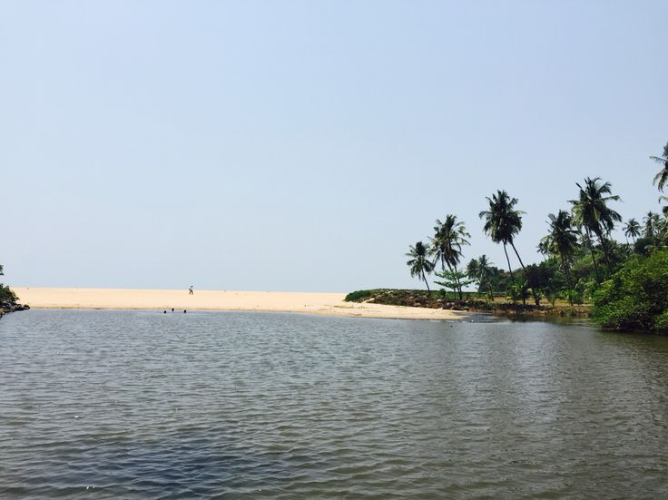 River next to the beach. This is a typical view of south India. A Sunday living in Kerala