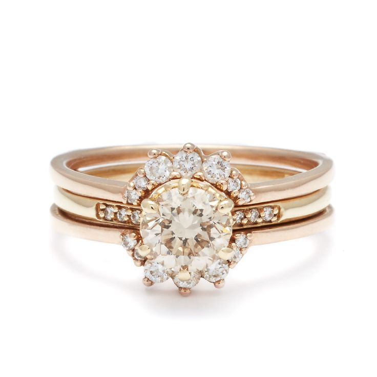 The Hazeline is a cornerstone of the Anna Sheffield ceremonial collection. A classic style with a delicate silhouette, this timeless design is based on a ring that belonged to Anna's grandmother. It is shown here with a brilliant champagne colored diamond in a yellow gold basket on a slender yellow gold shank.