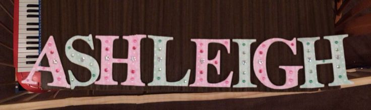 This is my first attempt at wooden letters with scrapbook paper and bling for my eldest daughter.