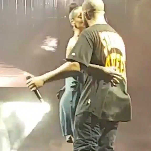Kiss me quick! As insiders claim Rihanna and Drake are officially dating, the pair let the...