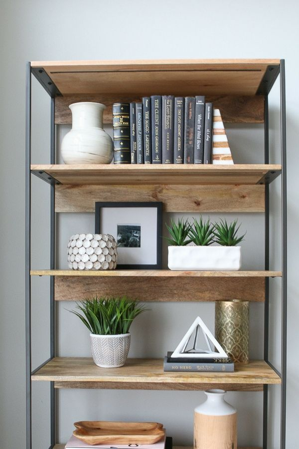 How to bring a bring a living room to life with home accents, plus a step-by-step on how to style bookshelves.