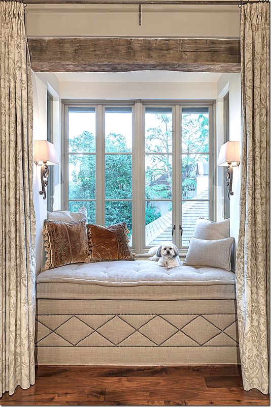 Wonderful window seat. Love the pillow and the curtains. Looks great with this color of wood flooring.
