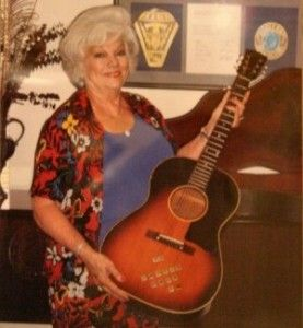 {*Anita Wood, Elvis's girlfriend in the 50's, before & when he went into the Army, here now days with guitar given to her by Elvis*}
