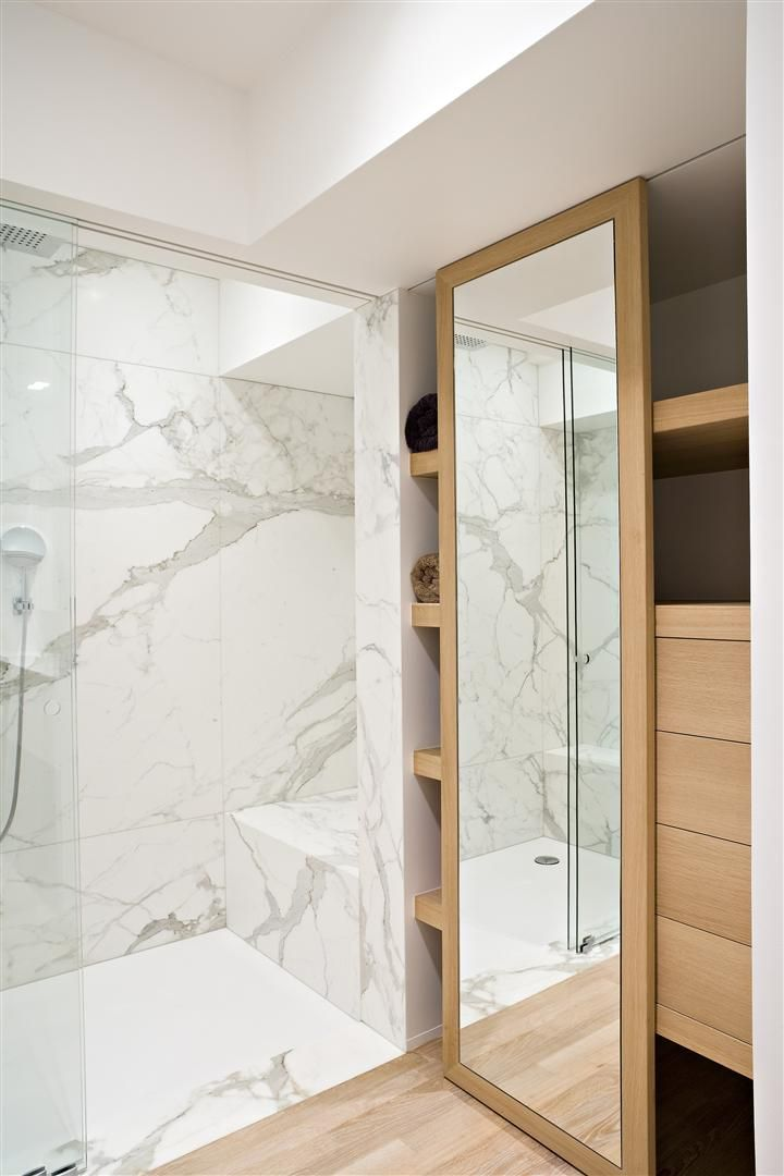 Bathroom with white Calacatta marble and wood.