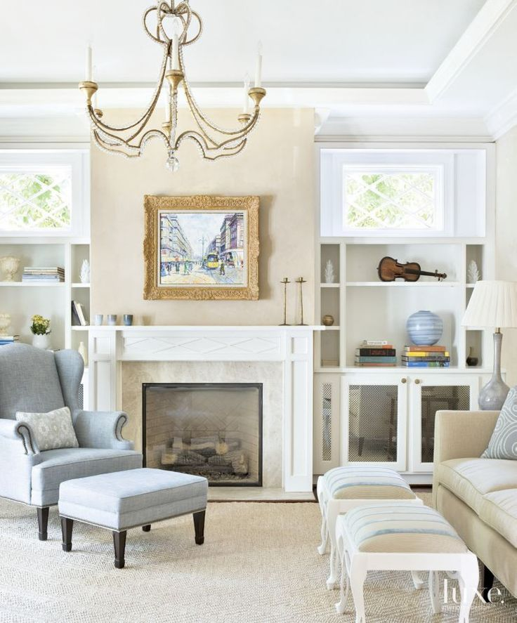 This serene living room features a soothing palette of white, cream, and  blue.