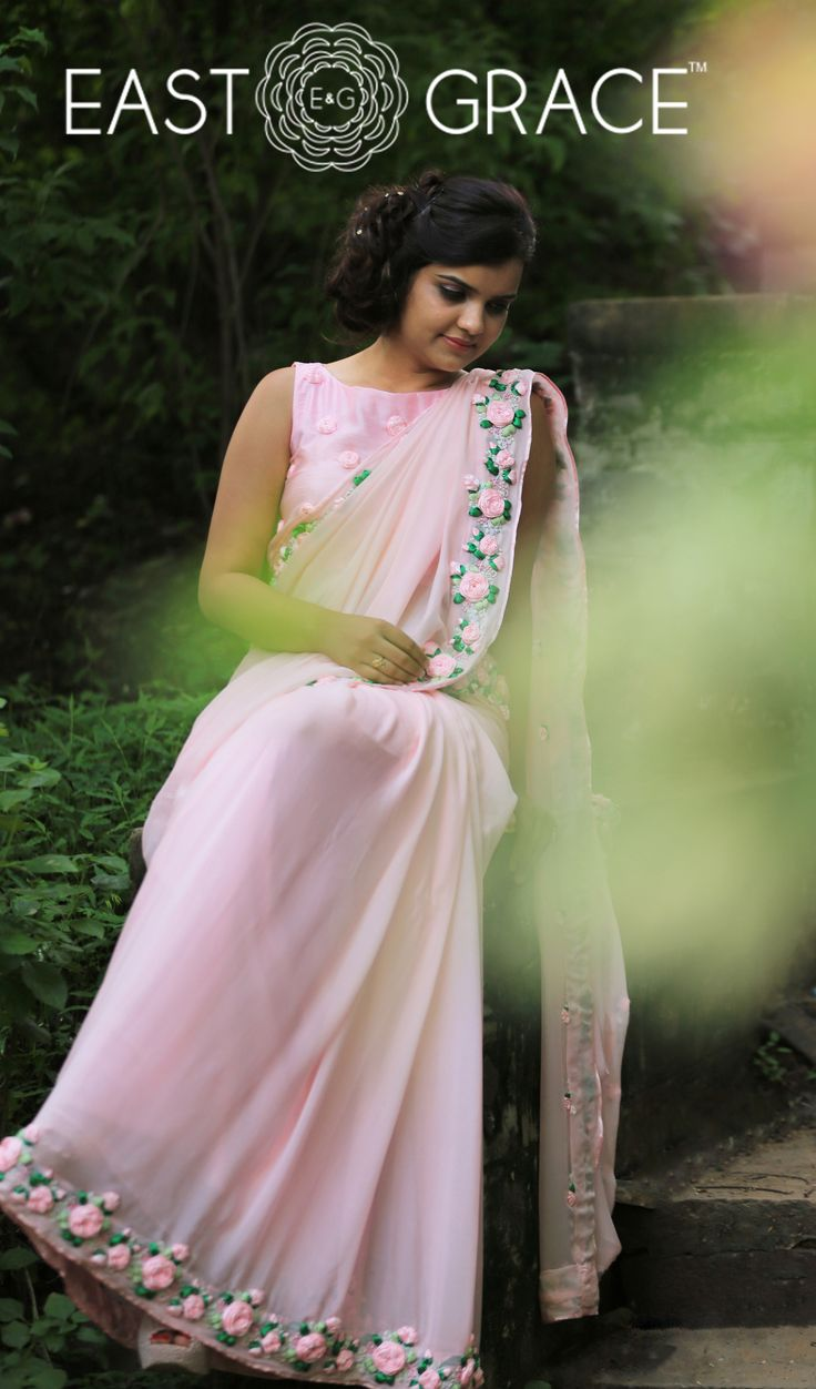 Presenting the Pink Rose. This ethereal frosted baby pink chiffon saree is adorned with roses on vines along the edges, crafted painstakingly with shades of pink satin ribbon and sprinkled with glistening pearls. It is embellished with French knots and glistening pink pearls. It comes with an unstitched raw silk blouse piece with baby pink rose buds and an unstitched matching satin petticoat fabric. PRICE: INR 16,932.00; USD 249.00  Please visit: https://goo.gl/dlv2pP; www.eastandgrace.com