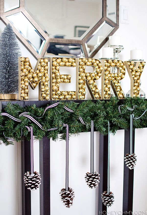 How to make a faux holiday marquee sign using gold decorative filler, and a simple pine cone garland to go along with it.