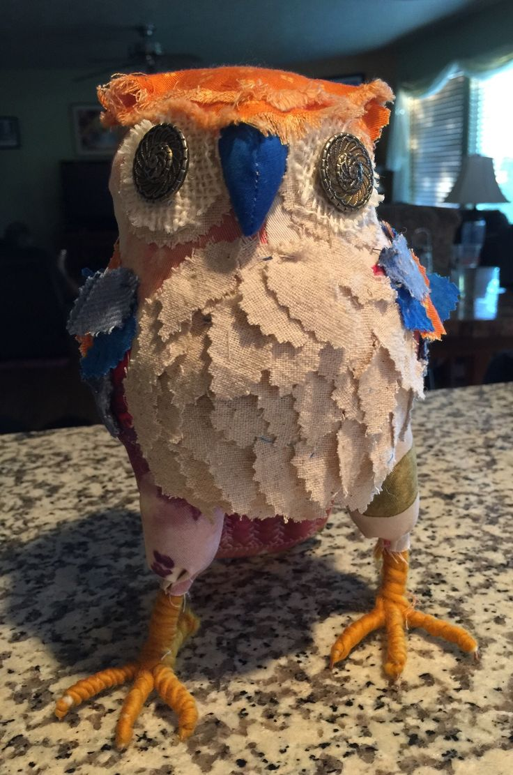Soft sculpture owl. Love the bright colors.