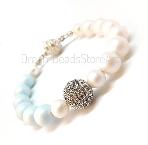 US26.00 Swarovski blue and white pears bracelet with sparkly pave beads. #swarovskijewelry #swarovskipearls #swarovskibracelet #pearl #pearljewelry #pearlbracelet #pearlbride #pearlwedding #whitepearl #bluepearl #giftforher #giftforwife #giftforme #giftfor mom