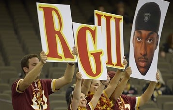 Fans in New Orleans hold up signs for Robert Griffin III before the quarterback's regular season debut against the Saints.  John McDonnell / The Washington Post
