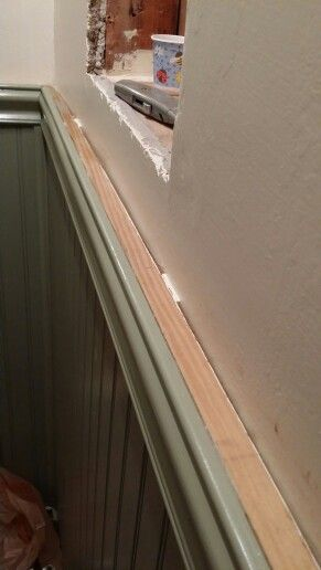 """3/4"""" capping spacer over tile cap which is screwed to the wall with 2"""" countersunk screws into plastic anchors. Moldings are glued; no nails. """"Loctite Power Grab"""" adhesive used. Stronger than nails & no nail holes to repair."""