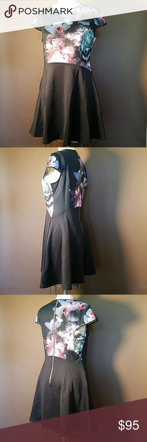Ted Baker Floral and Black Dress Beautiful floral designed dress from Ted Baker. The dress is brand new from Ted Baker, without hang tags.  The dress is missing a size label, but is pictured on a size 8 mannequin, and is just a bit big on the mannequin. Ted Baker London Dresses