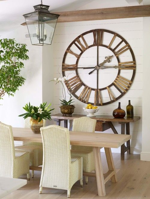 Crazy for Wall Clocks - Town & Country Living ~ A big clock over the entertainment center under railing to library.