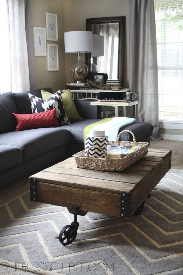 LivingRoom with green, gray, and red highlights. Modern with vintage chic.
