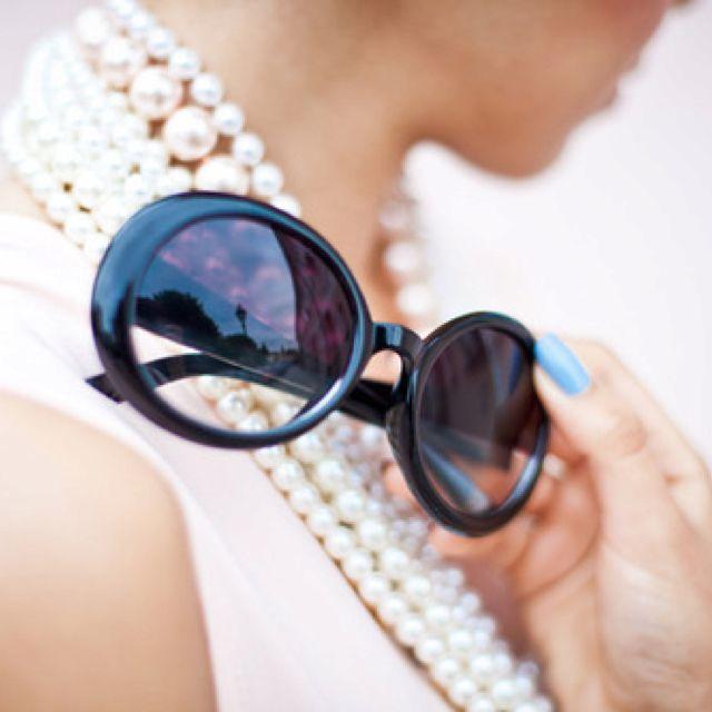 Pearls & large sunnies.