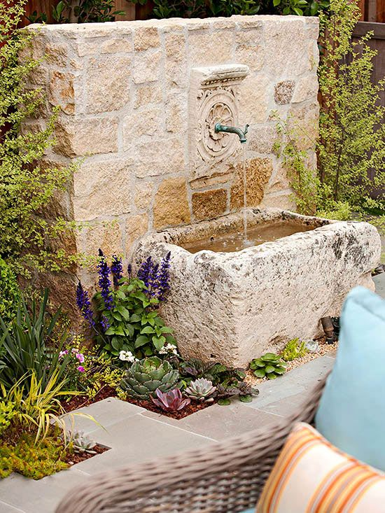 Water Feature - the fountain was originally a horse trough. Around it, planting insets bring a bit of garden into the space and a splash of color. These plants also provide an outline to the patio. I understand hummingbirds love to drink from flowing water like this...