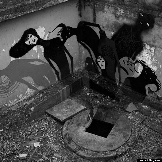 "For a project entitled ""1,000 Shadows,"" Brazilian street artist Herbert Baglioneinvaded abandoned psychiatric wards in Madrid, Paris and other undisclosed locales to add ghostly shadows to the already eerie buildings. Eeep!"