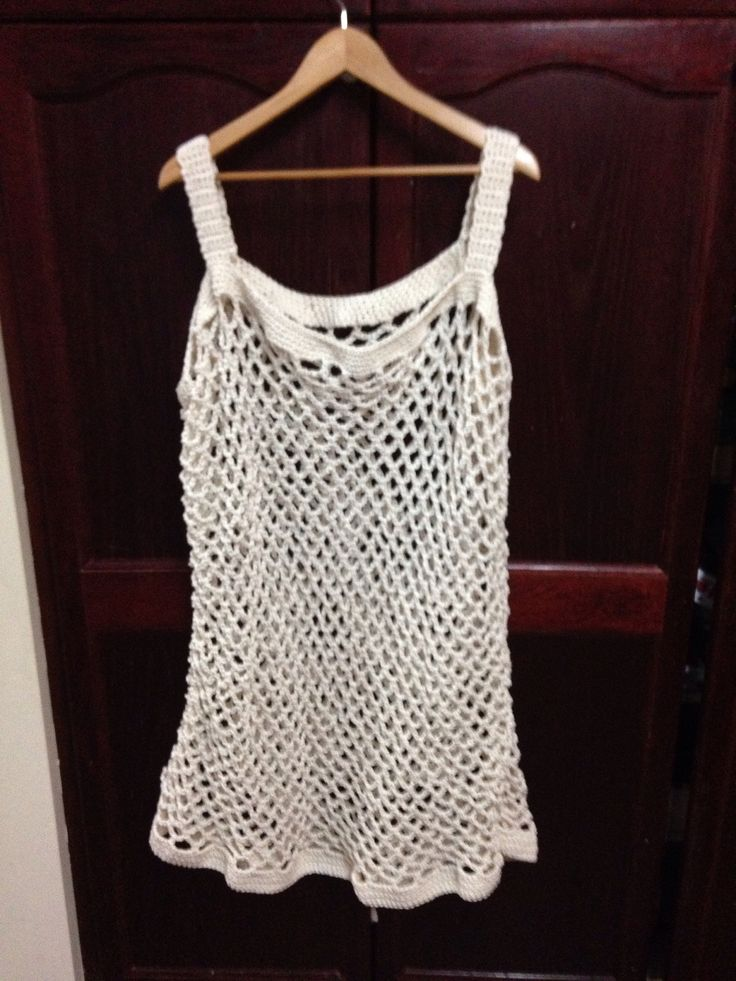 Crocheted bathing suit cover up.