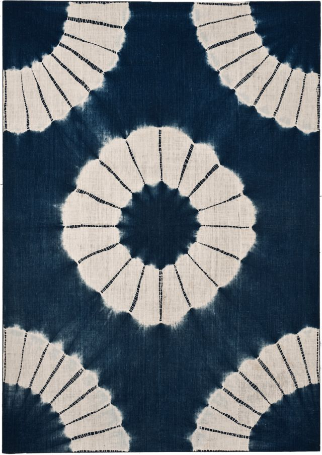 Japanese tie dye:  Kumo Shibori is a pleat and bound resist technique of…