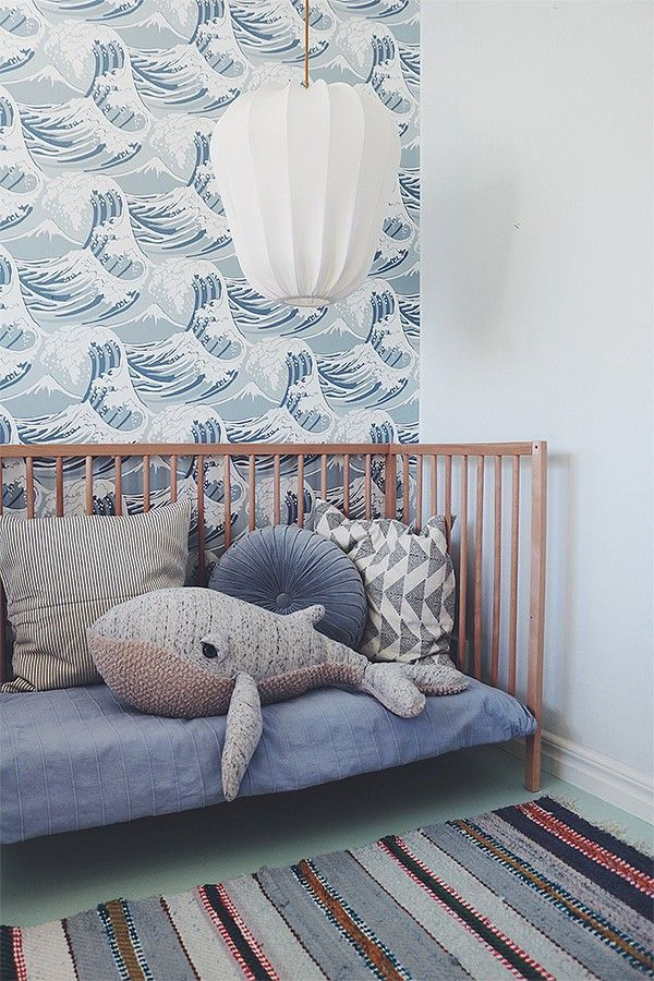 Children's room in gray, blue, white. The baby room is comfortably furnished, without