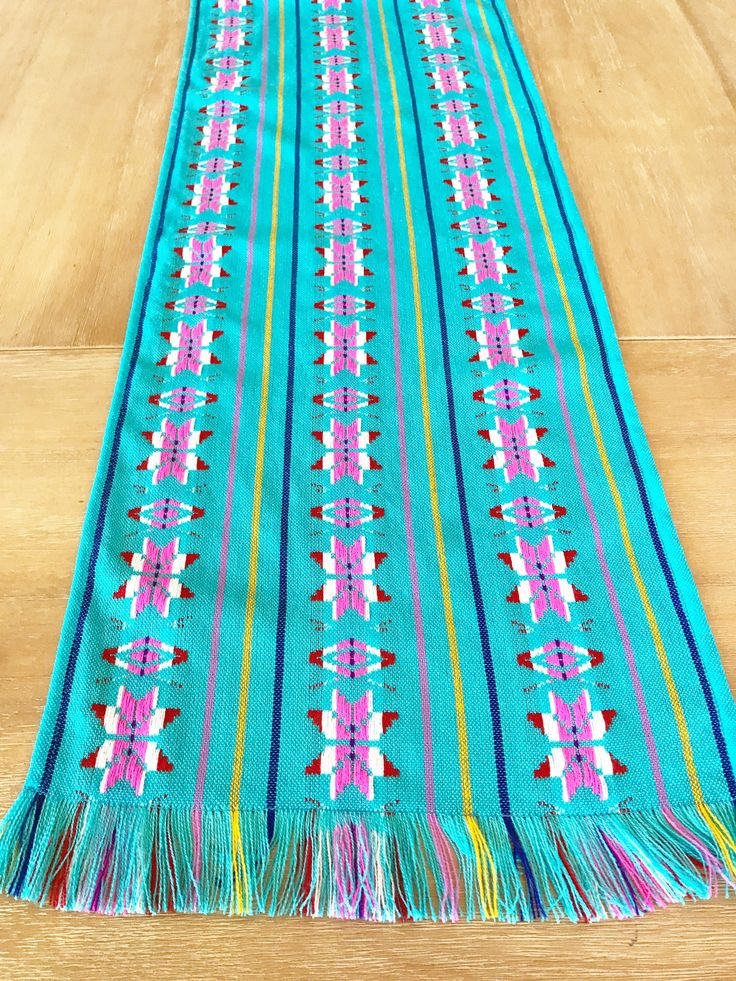A personal favorite from my Etsy shop https://www.etsy.com/listing/536720795/mexican-tablecloth-runner-or-napkins