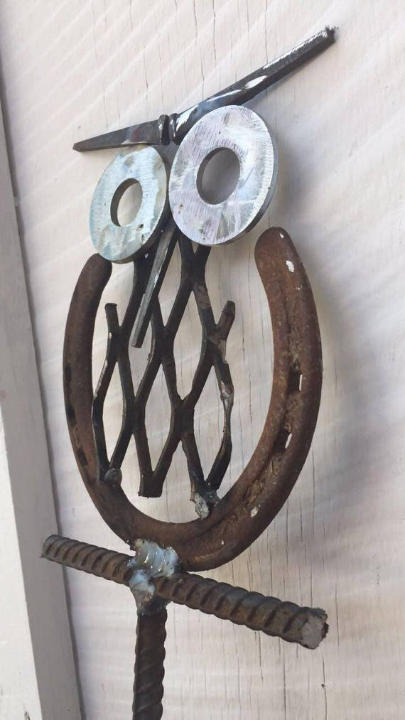 Owl made from horseshoe and recycled metal. Stands about 30 inches high.