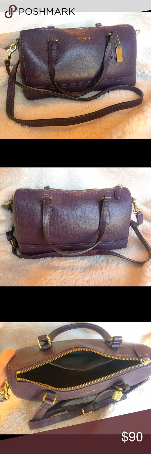 Coach Legacy Mini Satchel in Saffiano Leather Deep purple with gold hardware. Two small handle straps but comes with a long crossbody strap. Interior is grey with one pocket. Some discoloration on interior due to normal wear but exterior looks great! Coach Bags Crossbody Bags