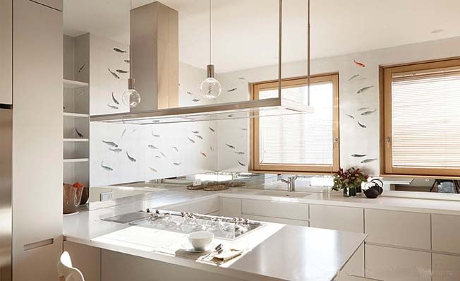 Modern chinoiserie 'Fish' by Misha wallpaper: Designer Valeria Cosmelli featured hand painted wallpaper Fish on Silver Leaves silk in the kitchen of a client's home in Milan, Italy
