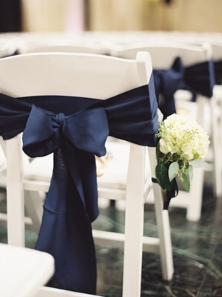 White Folding Chair with Navy Blue Bow