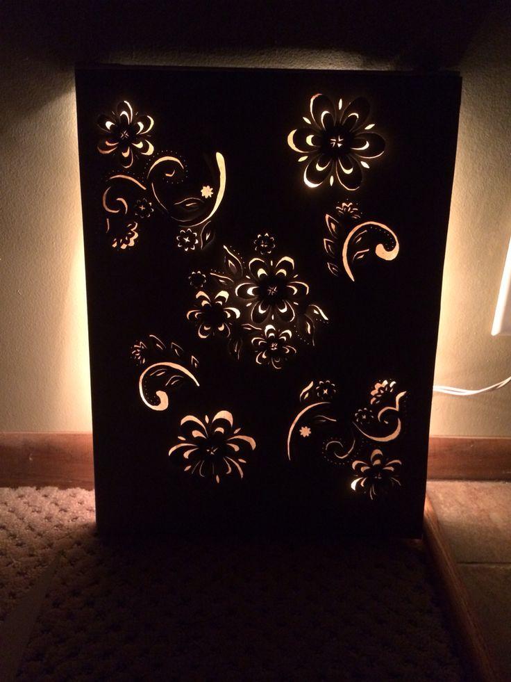 Backlit stenciled flowers canvas