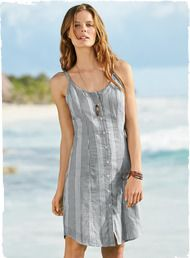 The ticking-stripe tank dress in cotton, with a buttoning front, spaghetti straps and shirt-tail hem.
