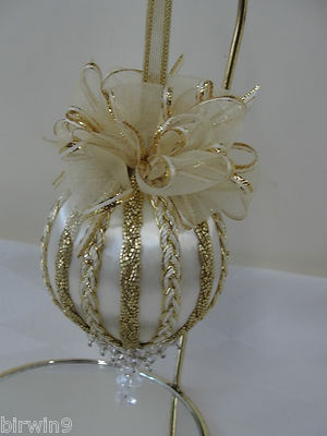 Christmas ornament with bows and trims