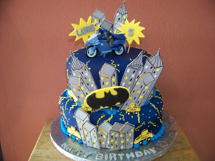 - VANILLA CAKE WITH ALMOND FONDANT. AIR BRUSH PAINT IN MIDNIGHT BLUE. PASTILLAGE CITY AND TAXIS.