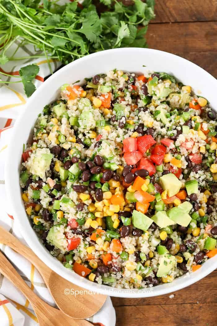 This is one of the best salads I've ever had! Black Bean Quinoa Salad features all of our favorite veggies in a zesty lime dressing!