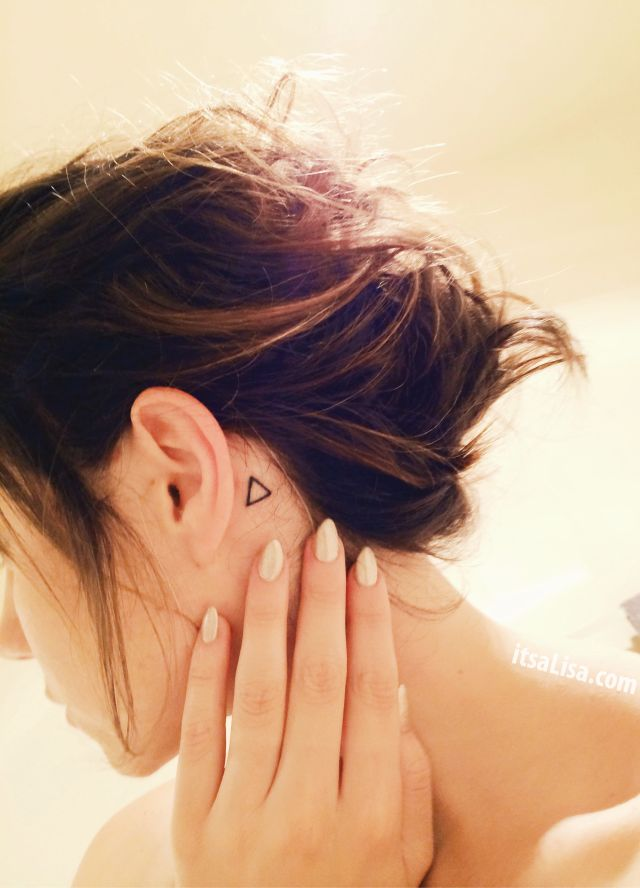 claw nails and simple behind the ear triangle tattoo