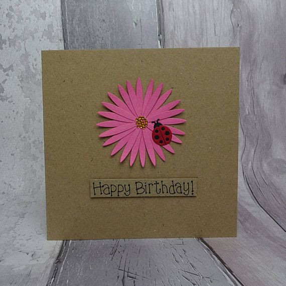 Ladybird birthday card with a large pink flower (gerbera daisy).  The colour of the flower on this handmade happy birthday card can be chosen from the drop-down menu. The sentiment on this ladybug birthday card is added with 3D foam and reads: Happy Birthday!. You can choose other messages or your own message on this ladybug birthday card for her from the drop-down menu.  This ladybird card would make a great birthday card for a Mum, daughter, granddaughter, wife or any fans of ladybugs or…