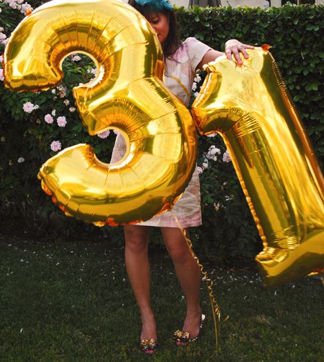 Giant gold balloon numbers. Not sure I want to spend $60 on balloons,  but good idea to reference.
