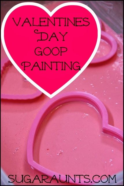 Goop sensory play turned painting fun for a creative messy Valentine's Day activity. By Sugar Aunts.