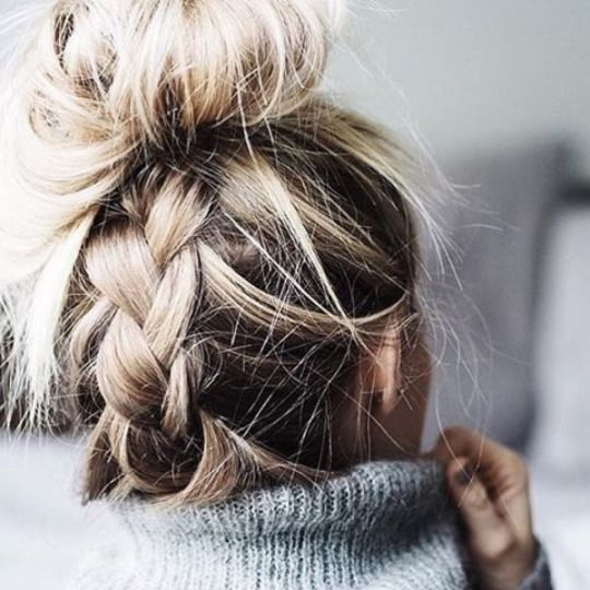 Make your messy bun look fancy, just add plaits.