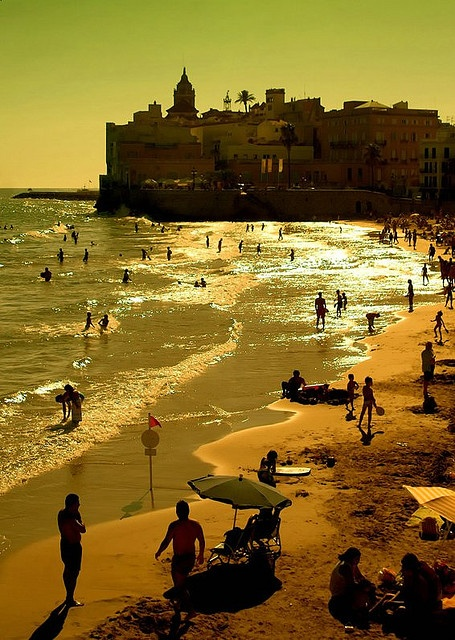 Sitges Beach in Catalonia, about 40min South of Barcelona. A small little white town which has a beautiful beach with warm water, narrow streets and wonderful atmosphere.
